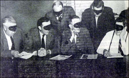 Members of AA wear masks during early AA press conference